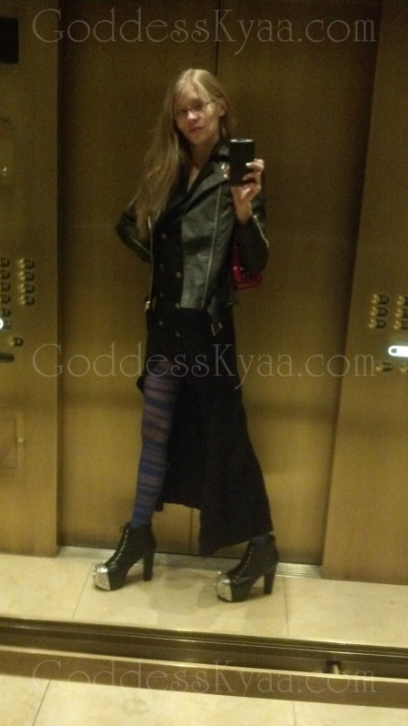 The elevators area all mirrored in Vegas and I can't help how vain I become when I look this kick ass. Spiked boots, spiked leather jacket and legs up to my neck. Even I want to fuck me.