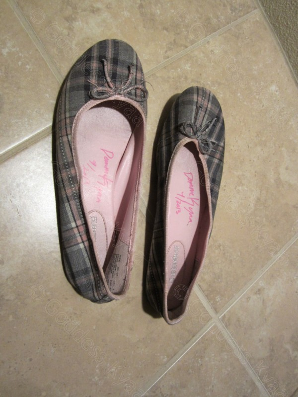 An old pair of flats, worn until they have started to turn black inside. Then signed and dated by you-know-who.
