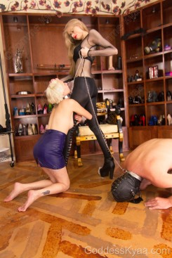 """Rexi West loves serving me. Towards the end of the shoot I let her hug my legs and the adorable look on her face in this photo inspired this caption: """"Please, no, Mistress! I don't want to leave your presence, please don't make me!"""""""