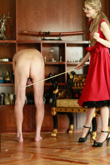 Only I could look so classically elegant as I break a cane over my slaves ass!