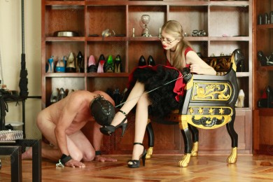 As I pull on his leash my gimp sniffs my perfect foot.