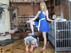 I look so gorgeous standing there with one foot on my slaves back.