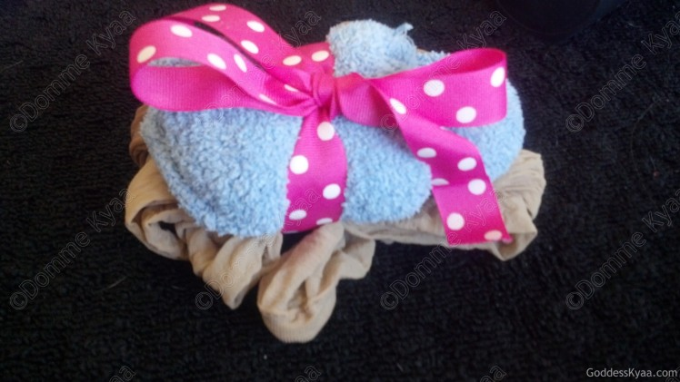 Pantyhose and socks tied together with ribbon!