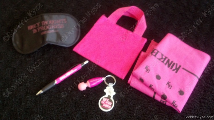 Assorted Kinkbomb swag, each package got a mix of these things, but may not include them all.